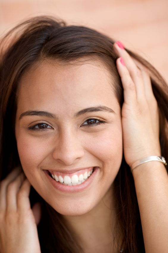 Woman with a perfect smile because of dental veneers.